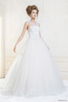 The lace motif neckline on this gown is amazing. Pronuptia.