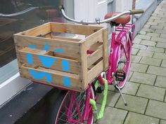 wooden crate on pink bike