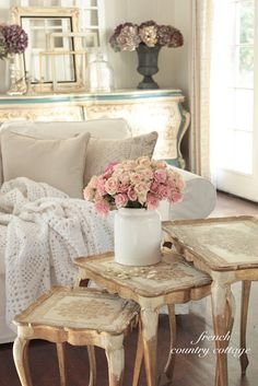 FRENCH COUNTRY COTTAGE: Our Home Loe the stacked frames on the sideboard, vase and hydrangea. Nice over the master bed @ cabin