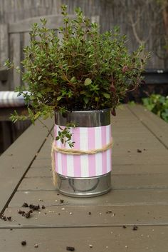 Big tin can...Wide blue ribbon, and lace or twine bow...Put a mum in it! Cheap and easy centerpiece!