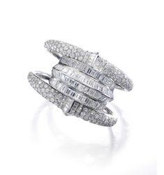 Suzanne Belperron diamond cuff bracelet (estimate: CHF 110,000 - 165,000/$124,599 - 186,899).