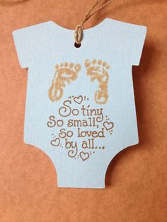 12 cute baby tags with an infant bodysuit design with twine. These baby shower tags will be unique to use for your next baby event. The favor tag has baby footprints on it as well as a darling message. These baby shower favor tags can either be baby girl tags or baby boy tags depending on the color of paper you choose. They also make great thank you tags to give to your guests with favors or prizes or something special to take home with them.  Included are 12 tags with twine attached Approx…