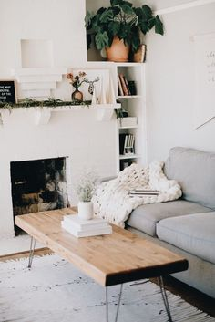 white wood and gray living room with built in shelves by the fireplace - very pretty and simple