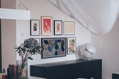 Gallery wall with the frame and bubble lamp