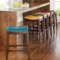 Julien Leather Bar Stool, Grandin Road.  Bright colors perfect!  I think blue or gold.
