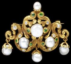 'The scrolling lines of this brooch, gold set with freshwater pearls, diamonds and demantoid garnets, combine historical, rococo elements with the sinuous curves of Art Nouveau. Such a combination may have been especially well received in America, where many did not react favourably to Art Nouveau's wilder statements: In 1901 the Jewellers' Circular and Horological Review commented that some pieces of Art Nouveau jewellery were perhaps 'more fitted for the case of the collector than for…