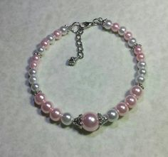 Check out this item in my Etsy shop https://www.etsy.com/listing/216879518/pink-and-white-glass-pearls-beaded
