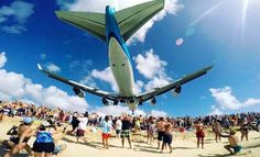 WATCH: KLM 747 nearly lands on beachgoers and 'blows people away'