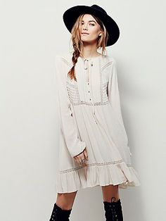Sweet Treat Mini Shirtdress | Effortless, crinkly shirt dress featuring soft pleating along the three-button placket. Subtle crochet cutouts and sweet ruffled hem. Elastic sleeve cuffs for an easy fit. Comes with a full lining.