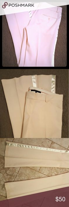 Theory cream stretch dress pants with satin trim Beautiful cream colored work pants from Theory. Features a slight flare at leg opening and a white Satin stripe down each leg. Has a good amount of stretch so they would fit up to a size 2 easily. Similar Theory styles retail for up to  $200! Theory Pants Trousers