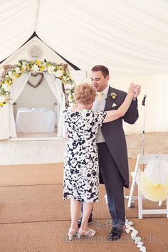 Groom dances with mother on wedding morning at Bournemouth Beach. Photography by one thousand words wedding photographers