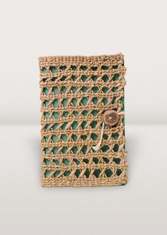 Got something to write about? Put your thoughts to paper in this woven pathi grass notebook complete with string and hand-carved wooden button.