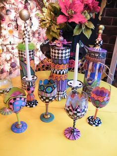 Handpainted wine glasses and wine bottle gifters