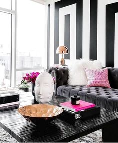 Stripes and pops of fuchsia? What else can we ask for in a room.