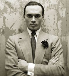Yul Brynner. Love the dark flower.