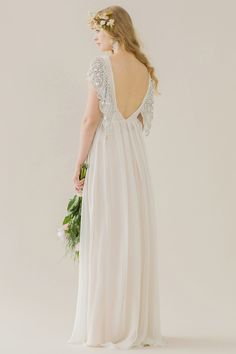 Sadi Dress - Rue De Seine: 100% Silk Georgette gown with a full skirt and deep V open back, hand embroidered butterfly sleeve detail and draped bust; A loose fitting silhouette.