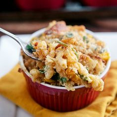 Baked Pumpkin Kale Macaroni and Cheese - a healthier twist on the classic comfort food. Full of veggies, but still tastes as cheesy as ever!