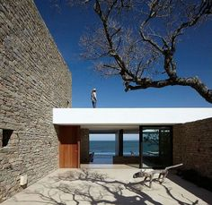 Buenos Mares Villa (designed by RDR Arquitectos) - beautiful entrance way with foyer view through to the water behind the house