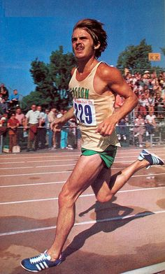 Pre takes a victory lap after winning the first heat of the 5000m event of the 1972 Olympic trials, Eugene Oregon. July 6, 1972. Sports Illustrated photo.