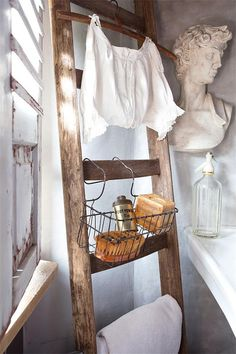 Jeanne d'Arc Living Magazine 7th Issue July 2014 by DwellAntiques - loving the rustic antique ladder leaning against the wall in the bathroom for hanging linens, baskets of soap, etc.