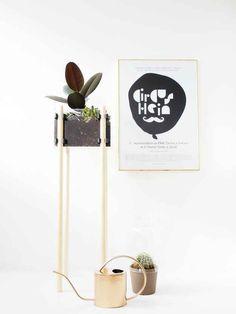 Assemble a skyscraper of a planter using wooden dowels.