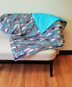 Boys Sensory Weighted Blanket in Aviator with Cuddle Dimple Teal Minky. This is a standard Throw Size 44x59 perfect for children or adults. USA Made by Elonka Nichole Designs