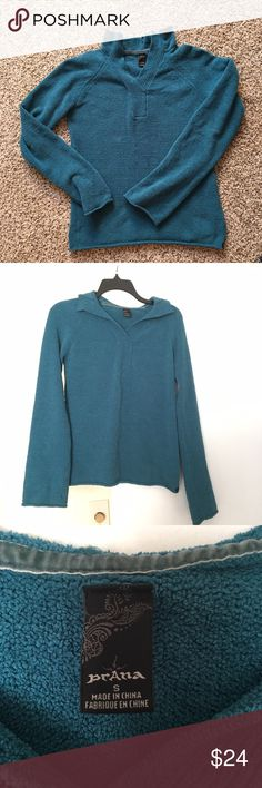 "PRANA Pullover Breathe Sweater, Aqua, Size S This Prana Breathe sweater is pre-owned. Has a small hole on the inside sleeve, but overall it's in nice condition. Kept in a smoke-free environment.   Size: Small Color: Teal Material: Unknown. Soft. I believe it's Acrylic Other: Comfortable feel. Frayed design at top of collar   Measurements*:  Under Arm to Under Arm: 16"" Length from Top of Shoulder to Bottom: 22""  * These measurements are deemed to be accurate, but not guaranteed. Prana Tops…"