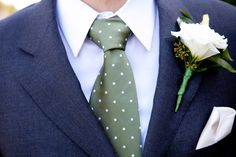 close up of groom's dark gray suit - olive green tie with white polka dots and white rose boutonniere - photo by Seattle based wedding photographers La Vie Photography