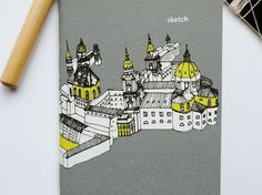 One notebook with sketch of Salzburg, Austria on front and back cover. Please let me know if you want travel as the cover title or your choice of a one