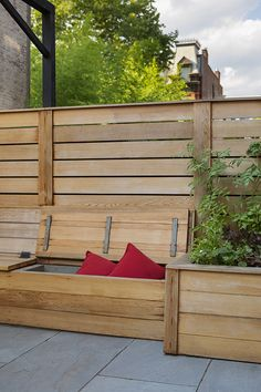 Custom built outdoor seating with storage. This bench is built from clear cedar and can store cushions, etc. Fencing and planters are also clear cedar for a cohesive and custom look. Outdoor Seating, Outdoor Decor, Porch Swing, Fencing, Design Projects, Landscape Design, Planters, Bench, Cushions