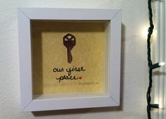 A shadow box with a copy of our first apartment key!