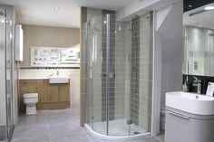 The large Room H2o bathroom showroom shows off some of its' Marazzi floor tiles alongside the showers and bathroom fittings.  #bathroom #tiles #showroom