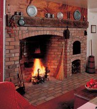 Large fireplace with Bee Hive Oven. I love these. I could never live in a house without a fireplace.