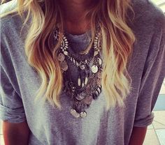 Dress up a plain tee with a necklace. Love her hair too!
