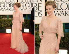 Champagne wishes: Scarlett Johansson looks ravishing in an embellished dress that matches her skin tone at the 68th Annual Golden Globe Awards in 2011.