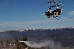 A Breckenridge chairlift ascends over a snow-making machine.| Frugal world traveler Colorado