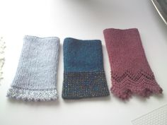 My various tests of wristwarmers Spring 2011. The upcoming designs Victorian (right. Finnish combed silkwool) and Rococo (left. babyalpaca/silk). The sample in the middle is a design made in early 2000 (alpaca)