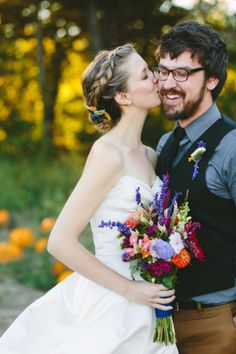 Gorgeous electric colours in the bouquet, brides pretty up-do and the grooms relaxed style... <3 it all!