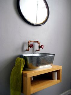 Homemade sink with galvanized wash basin and brass taps in the Mexico City home of Enrique-Arellano-and-Libia-Moreno via DS |Remodelista