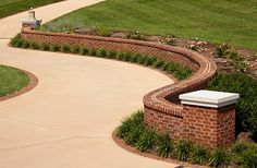 This beautiful serpentine brick wall features a Flemish bond pattern finished with rowlock coping. Learn more about what you can do with brick at http://insistonbrick.com/.