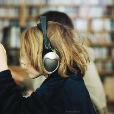 HEADPHONES: an electrical device consisting of two earphones held in position…