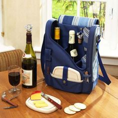 """Compact Thermal Shield insulated wine and cheese cooler includes: Acrylic glasses, napkins, corkscrew, bottle stopper, cheese knife, and hardwood cutting board. This unique set holds two bottles and can be used as a three bottle carrier with glasses removed. Includes adjustable padded bottle dividers. Attractive slim profile case has a comfortable adjustable shoulder strap to carry. Designed and assembled in the USA. Dimensions: 13.75""""L x 10.5""""W x 4""""H Weight: 2.2 lbs. Please allow two ..."""