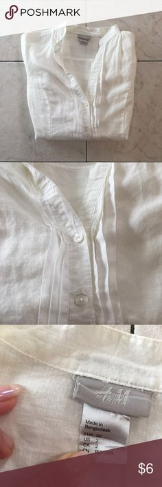 H&M White Button-Up Top H&M White Button-Up Top - Size 2. Has been worn a couple times, still in great condition. Made in Bangladesh, 100% Ramie  Bundle & Save! Free Gift with every purchase! 💰✨ H&M Tops