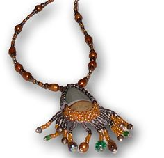 Imperial Jasper and the sub-variety known as Royal Imperial Jasper are found in Zacatecas, Mexico. Created by Black Hills artists. http://www.dakotanature.com/products/imperial-jasper-necklace