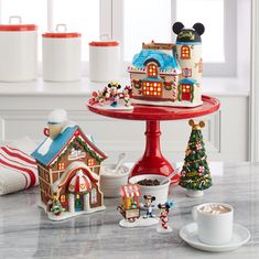 Mickey, Minnie, Donald and the whole gang are part of this colorful Disney themed Christmas Village by Department Mickey Christmas, Disney Home Decor, Disney Crafts, Christmas And New Year, Christmas Time, Xmas, Holiday, Merry Christmas, Navidad