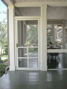 My kingdom for a screened porch like this! Love painted porch floors too--cool, clean, airy, restful.  [v]