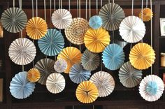 26 Paper Rosettes / Yellow / Grey / Blue.  hanging instead of board?  both?