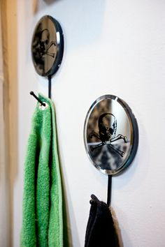 Detail of hand towels with grommets hung on urban outfitters hooks.  View full bathroom on Houzz.com - http://www.houzz.com/ideabooks/9618710/list?utm_source=Houzz_campaign=u286_medium=email_content=gallery9