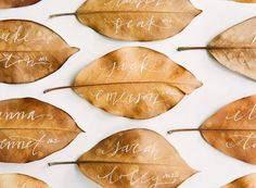 Calligraphied leaves make simple and elegant place escort cards. | 42 Lovely Ideas For A Cold-Weather Wedding