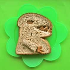 BentOnBetterLunches: 101 Peanut Butter Sandwiches. No real directions, but tons of pics of different ways to serve/cut up peanut butter sandwiches. This dinosaur was one of my favorites.